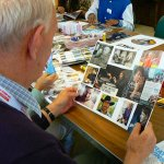 Client living with dementia viewing their collage